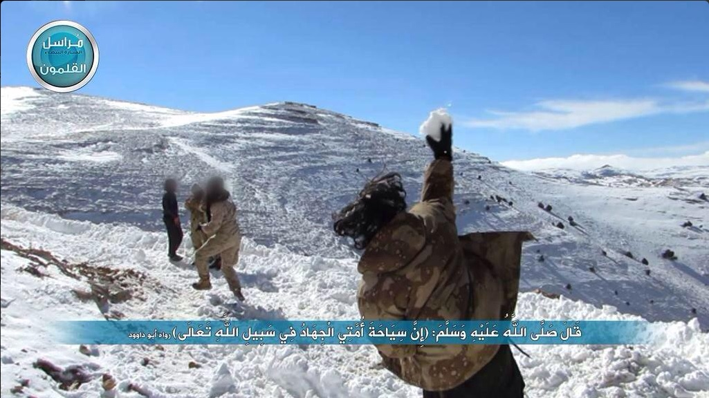 JaN fighters frolick in the snow of the Qalamoun mountains.