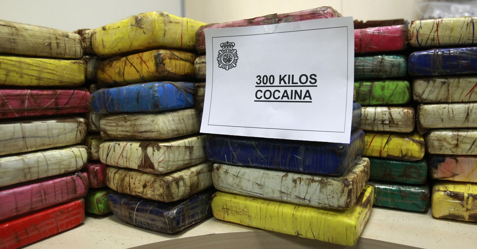 Packages of confiscated cocaine weighing 300 kilograms (661 pounds) are displayed at a police headquarter in Madrid January 18, 2011.