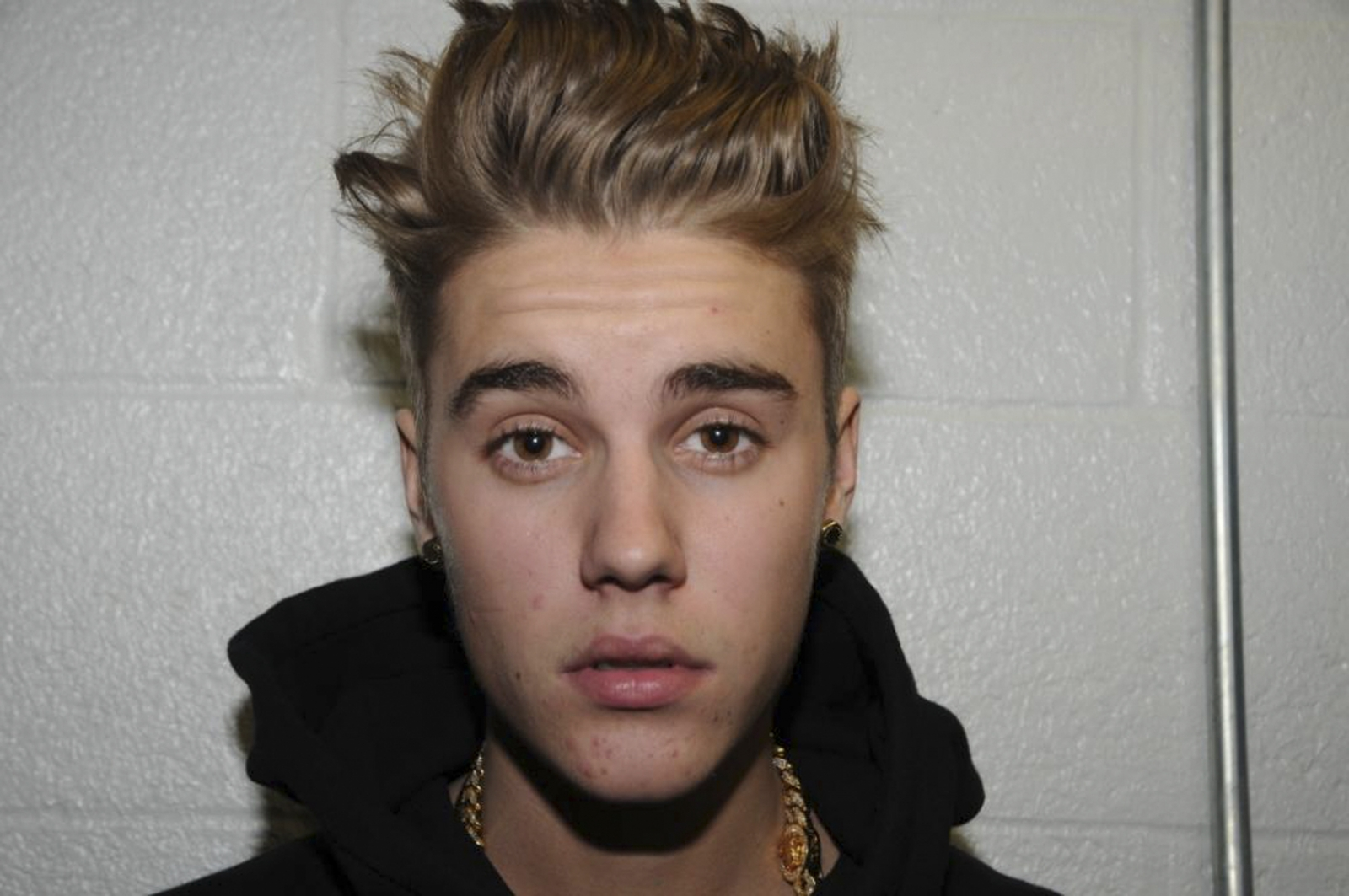 Canadian pop singer Justin Bieber is pictured in police custody in Miami Beach, Florida