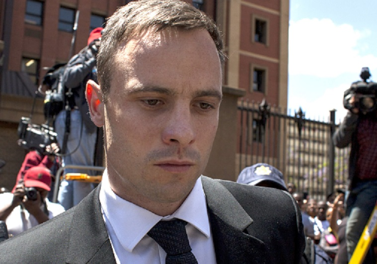 Oscar Pistorius is growng a beard and dresses in a regular orange prison uniform, revealed brother Carl