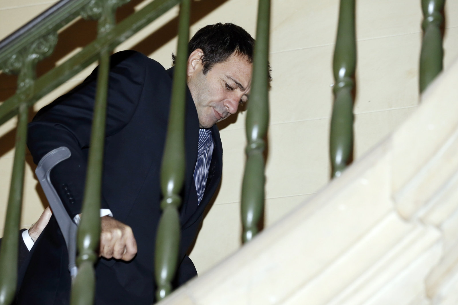 Ian Griffin on crutches at court in Paris where he denied murdering Kinga Legg