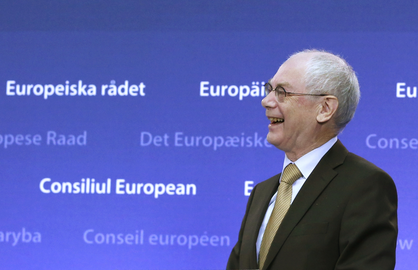 Outgoing European Council President Herman Van Rompuy smiles during a ceremony with former Polish Prime Minister, Donald Tusk (not in picture), during which Tusk took over from Van Rompuy replacing him as head of the European Council, in Brussels, Decembe