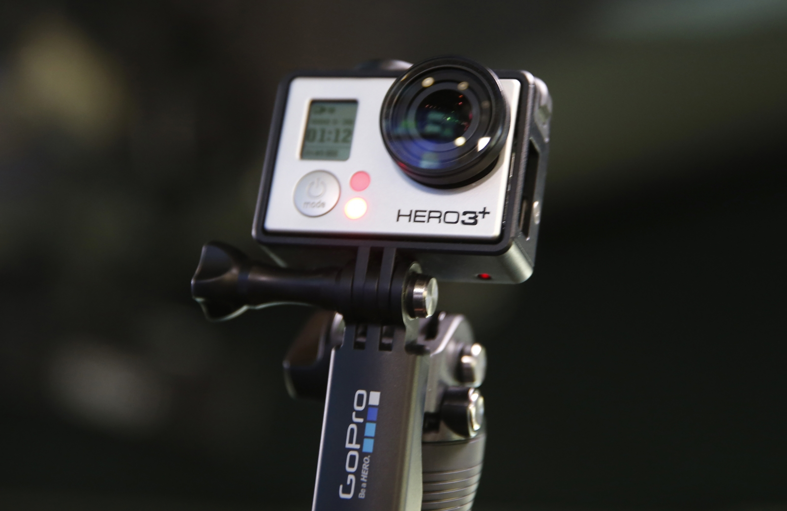 A GoPro Hero 3  camera connected to an extendible tripod