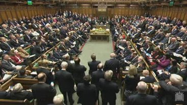 MPs stand in parliament for Osborne's Autumn Statement announcement