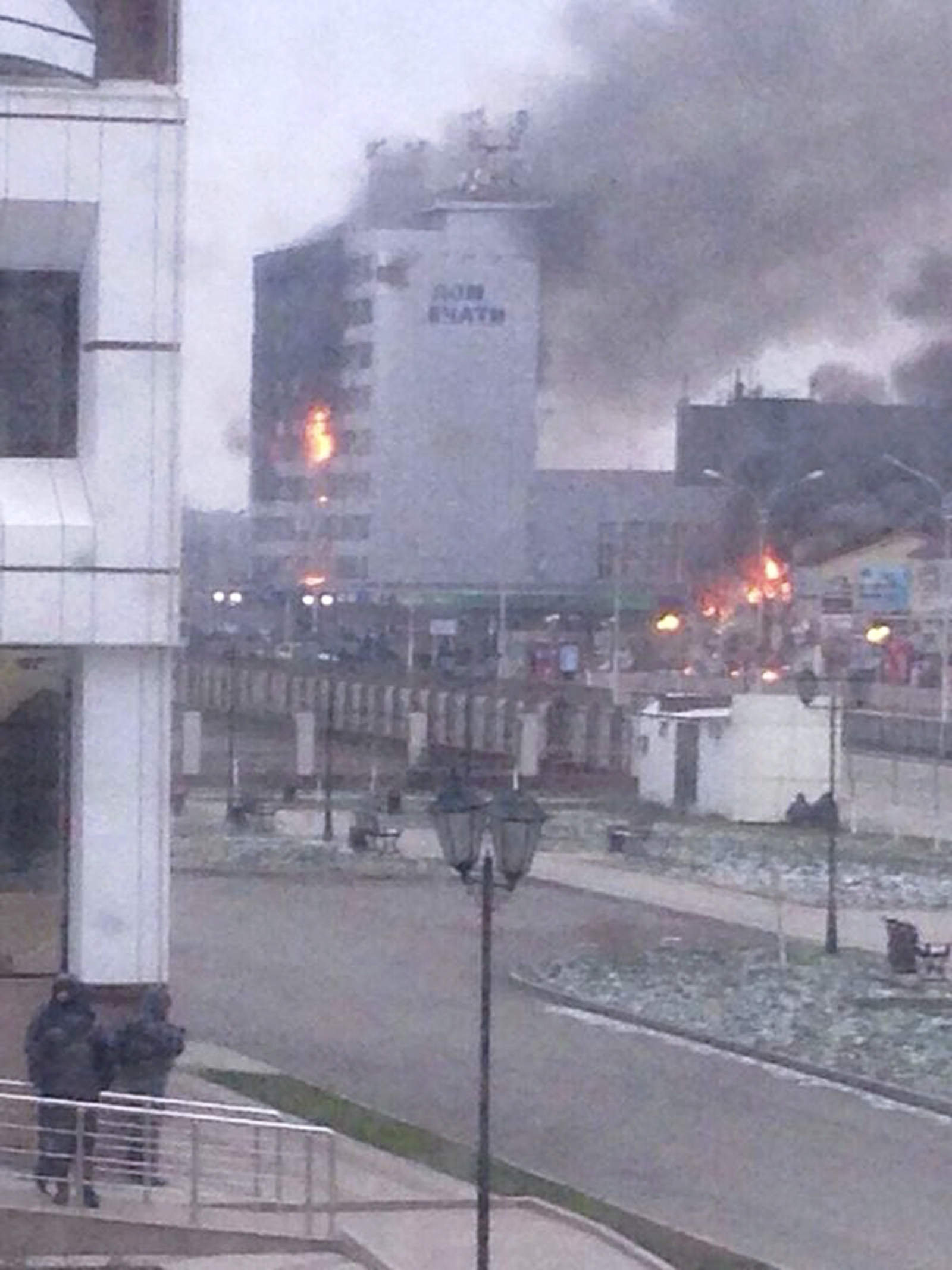A local media building known as the Press House burns as militants attack in the Chechen capital Grozny, December 4, 2014.