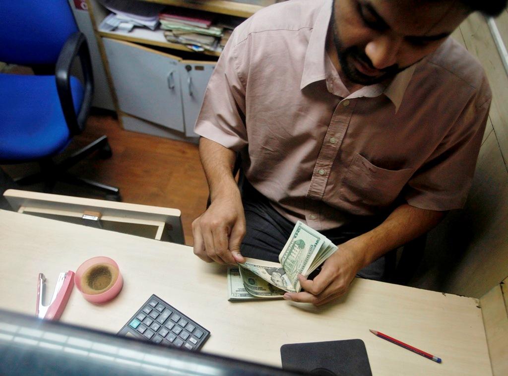 Indian Bank Employee Counting Dollar Bills