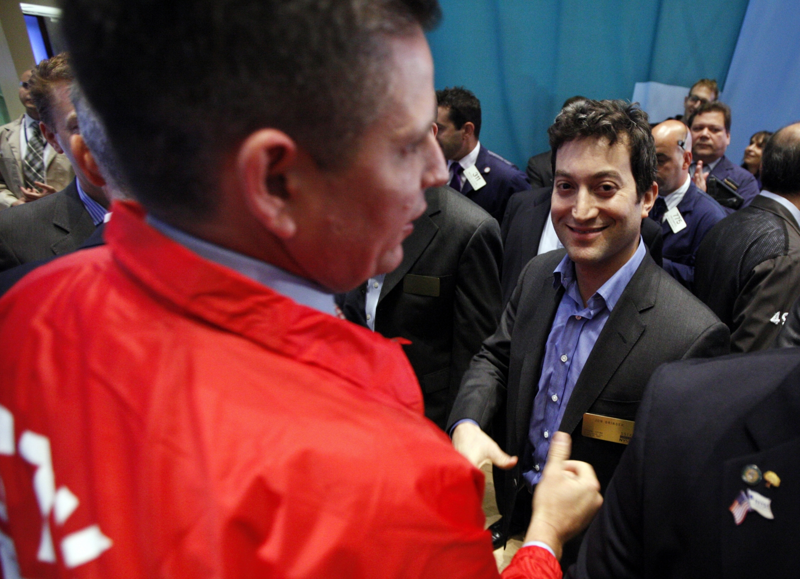 Shutterstock founder and CEO Jon Oringer (R) celebrates his company's first trades following it's IPO on the floor of the New York Stock Exchange, October 11, 2012.