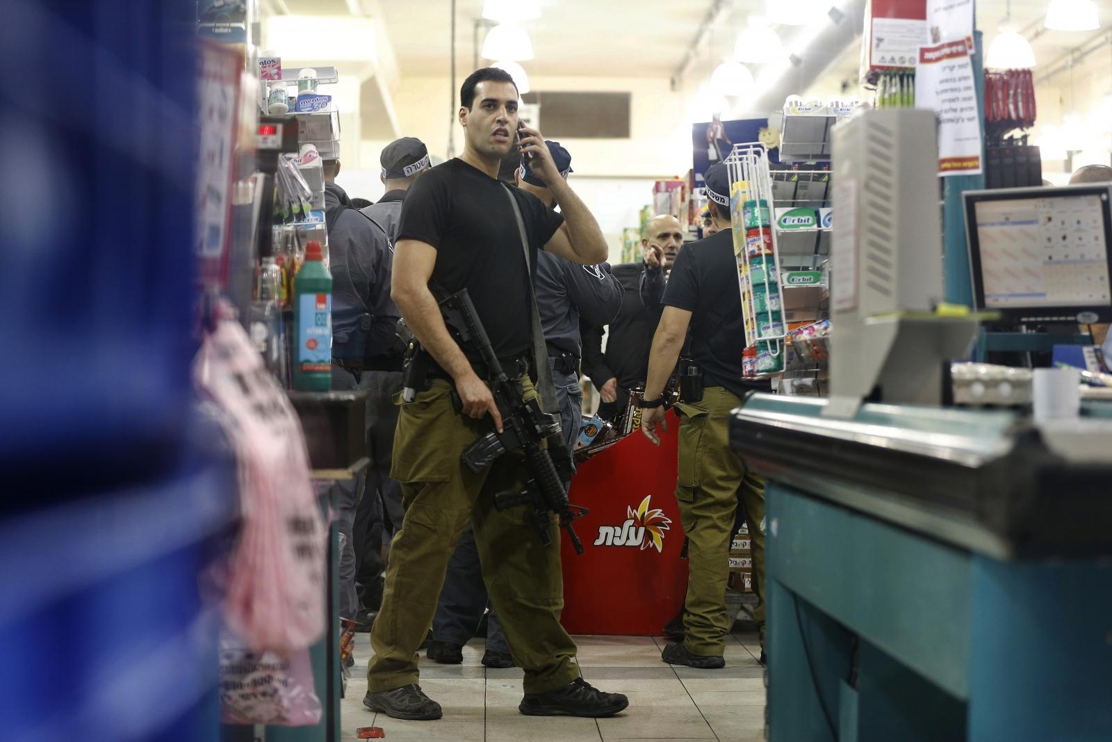 Rami Levy supermarket stabbing west bank attack