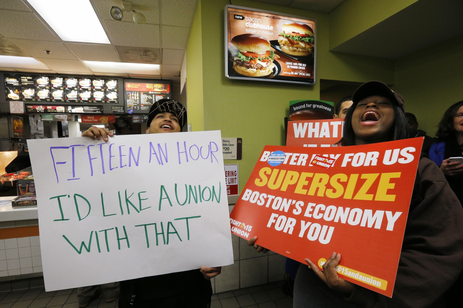 Scores of fast food workers and their supporters calling for a $15 minimum wage fill a McDonalds restaurant in Chelsea, Massachusetts December 4, 2014.