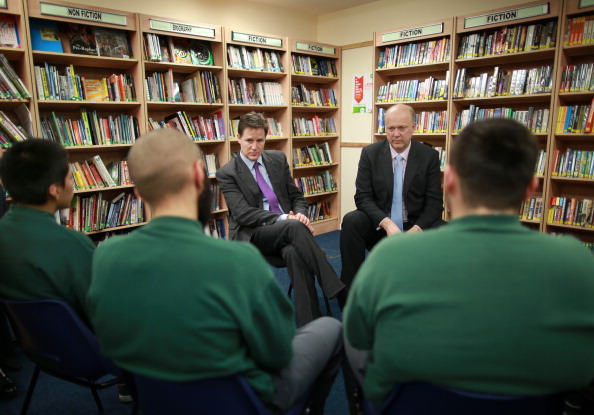 Deputy Prime Minister Nick Clegg (3L) and Justice Minister Chris Grayling (2R)