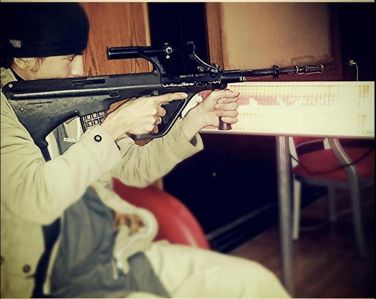 Ali Kalantar poses with gun