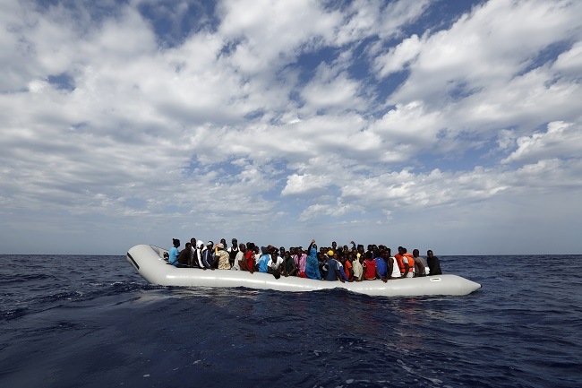 rubber dinghy with 104 sub-Saharan Africans on board waiting to be rescued by the NGO Migrant Offshore Aid Station