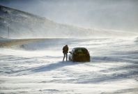People push a car stuck on the A93 Braemar to Glenshee road, Scotland