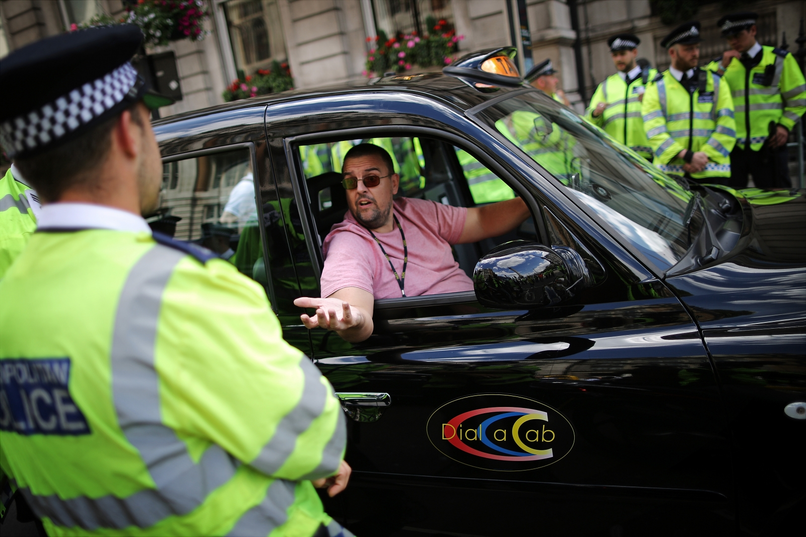 Black taxi driver during protest against cab app Uber in London