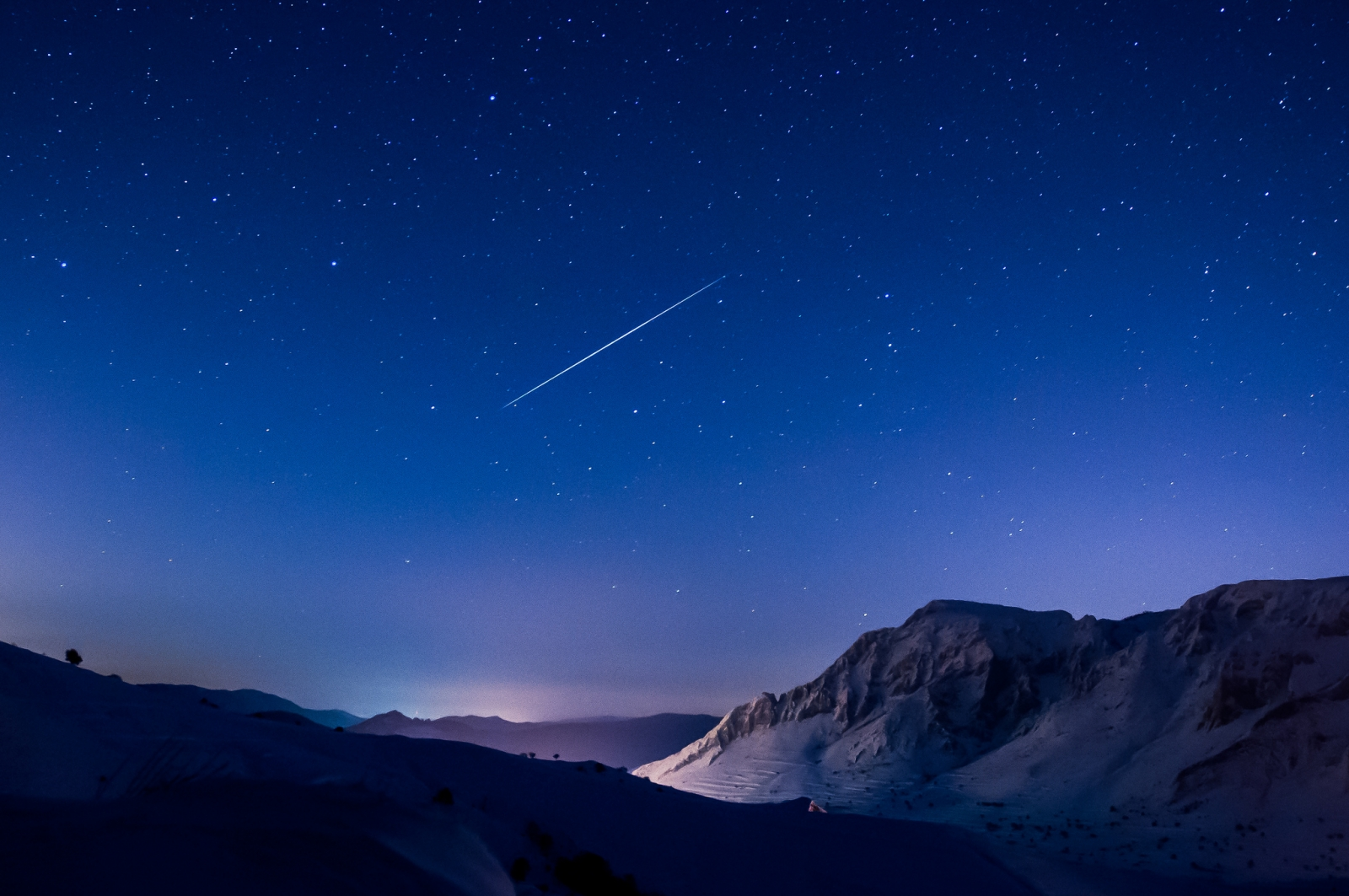 A single shooting star captured during the Geminids meteor shower in 2012