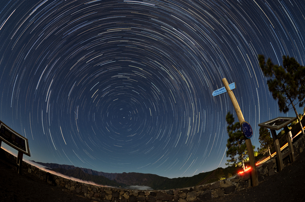 A photograph of star trails comprised of long exposure images edited together using the Star Trails freeware