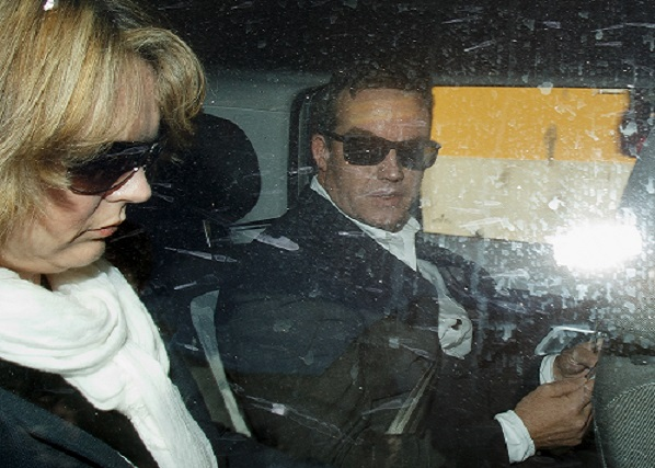 Robert Murat (right) and wife Michaela Walczuch leave Faro Police Station after police interview