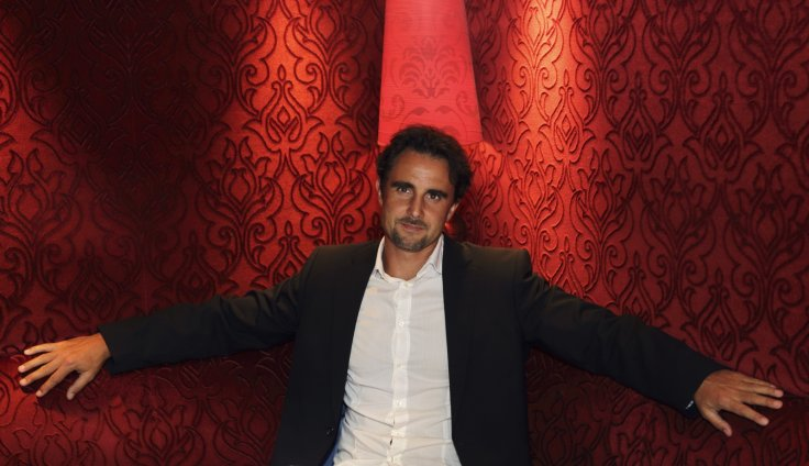 Herve Falciani, an ex-HSBC employee wanted in Switzerland on charges of stealing data on bank accounts, poses in a restaurant prior to an interview with Reuters in Paris July 17, 2013