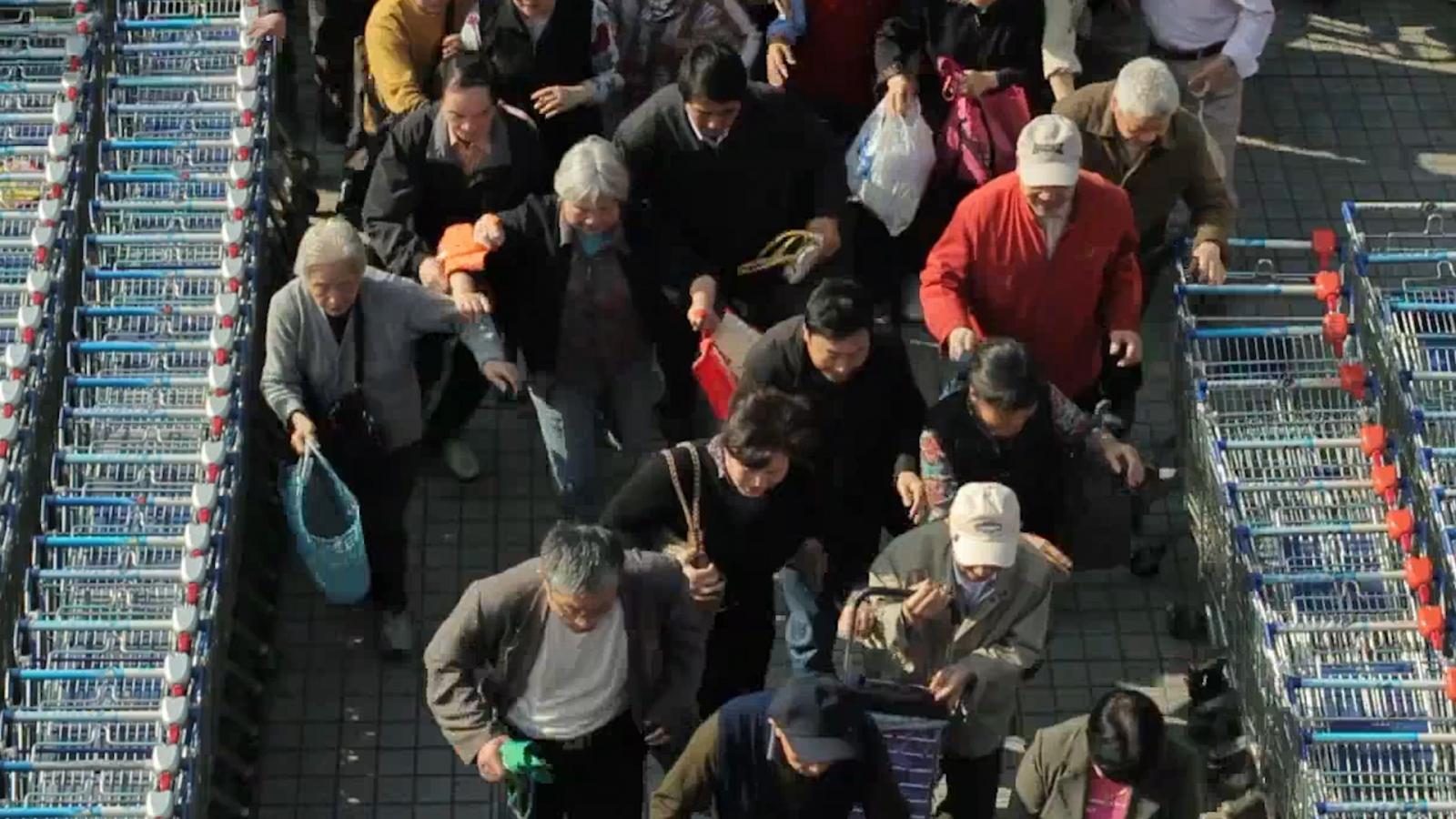 Elderly Chinese shoppers rush to enter Shanghai Tesco