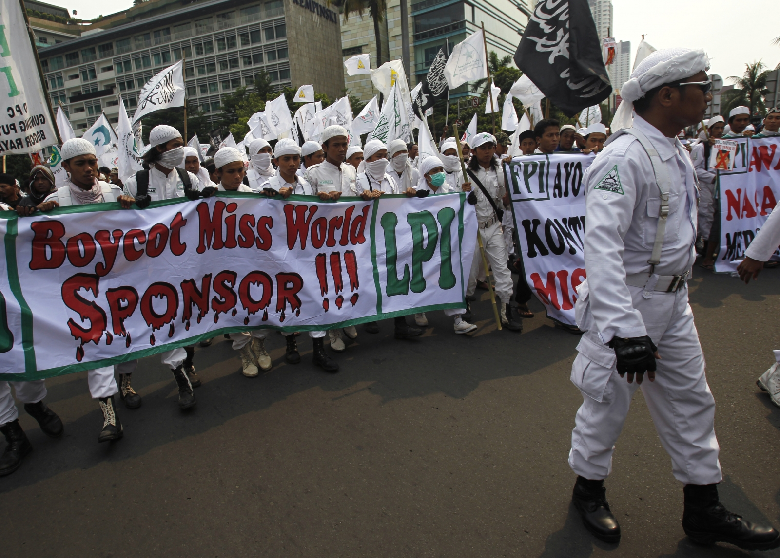 Indonesian hardliner Muslim protesters shout slogans during a protest against the Miss World pageant in Jakarta in 2013