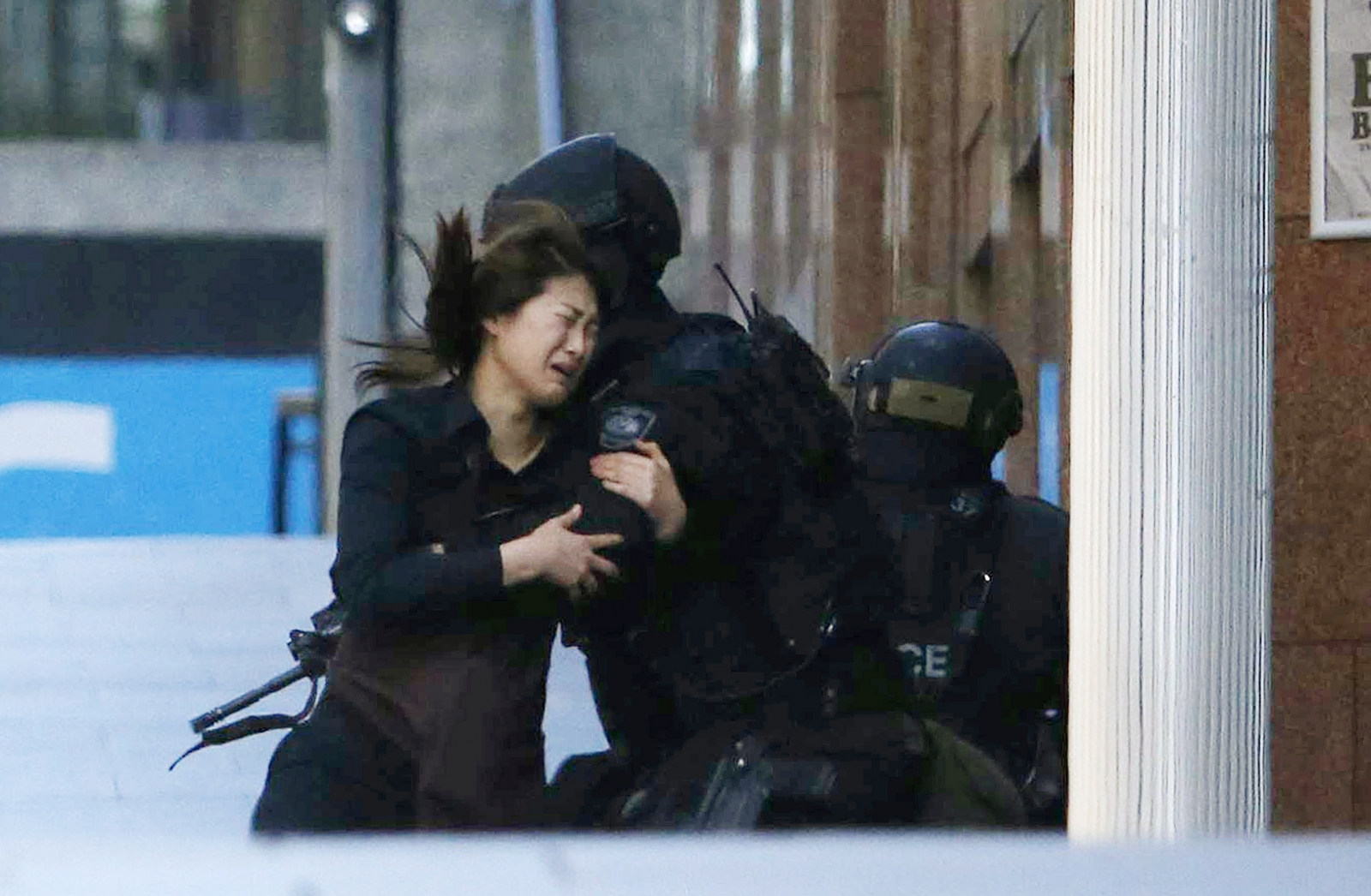 Sydney Seige: Hostages are seen fleeing Lindt Café