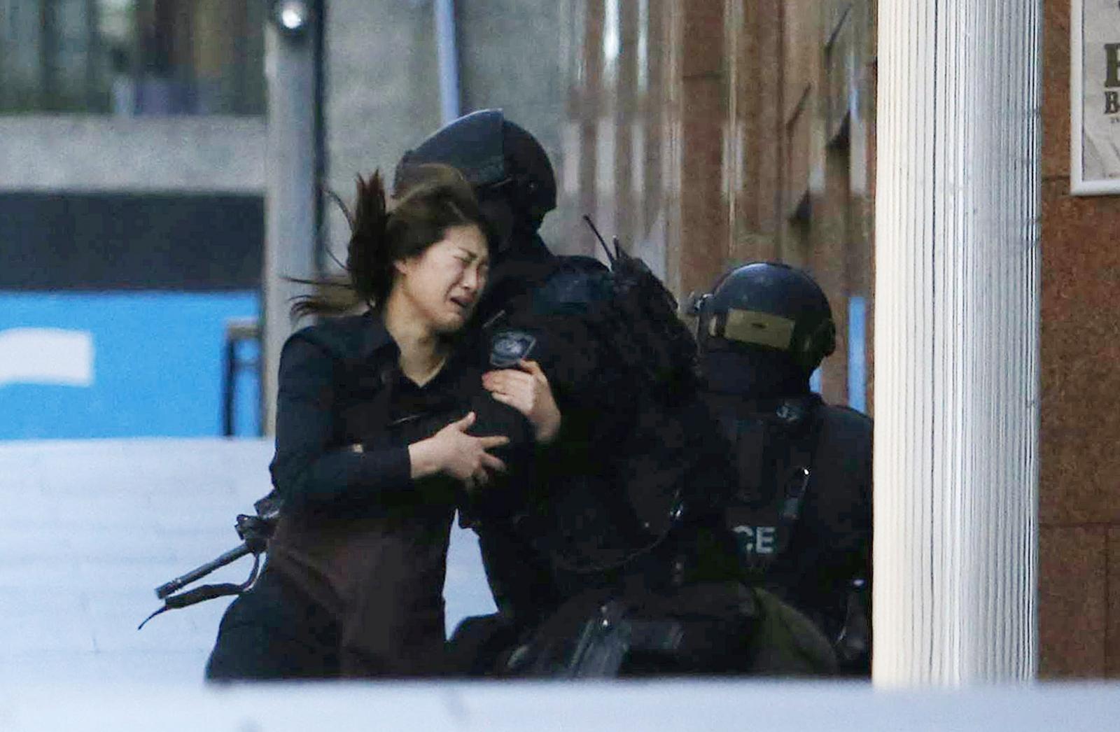 Sydney Seige: Hostages are seen fleeing Lindt Café