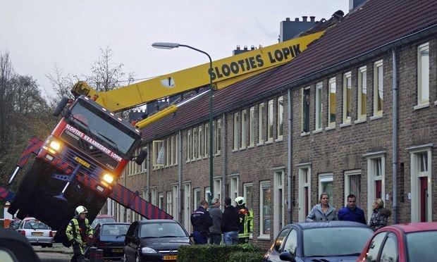Dutch man crashes crane into house twice during marriage proposal