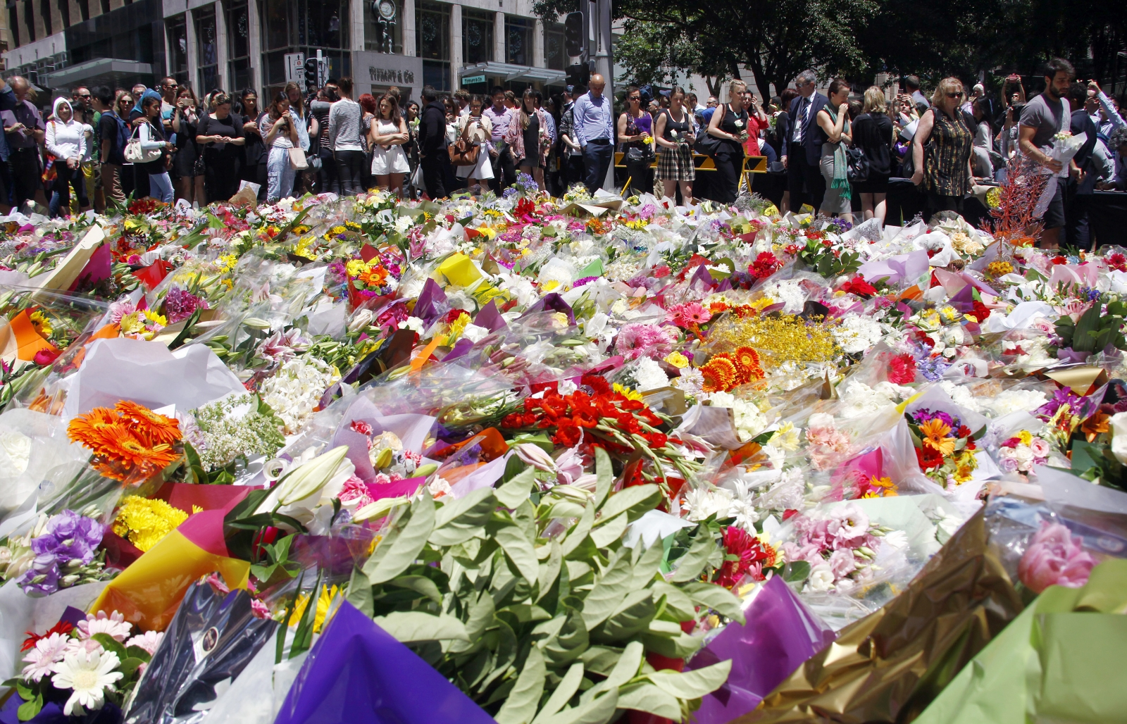 Sydney cafe siege tributes and investigation