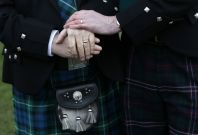 Larry Lamont and Jerry Slater (R) take part in a symbolic same-sex marriage outside the Scottish Parliament in Edinburgh, Scotland February 4, 2014. Scotland voted on Tuesday to allow same-sex marriages, becoming the 17th country to give the green light t