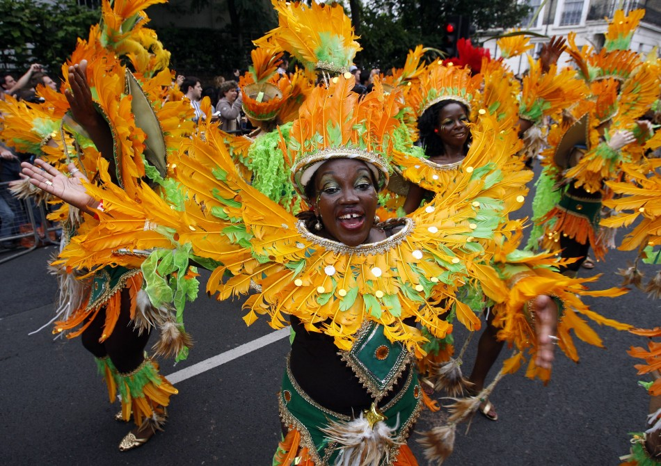 Performers dance at street parade at annual Notting Hill Carnival in central London