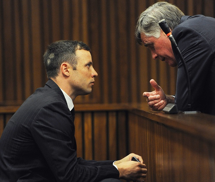 Brian Webber and Oscar Pistorius talk during his trial