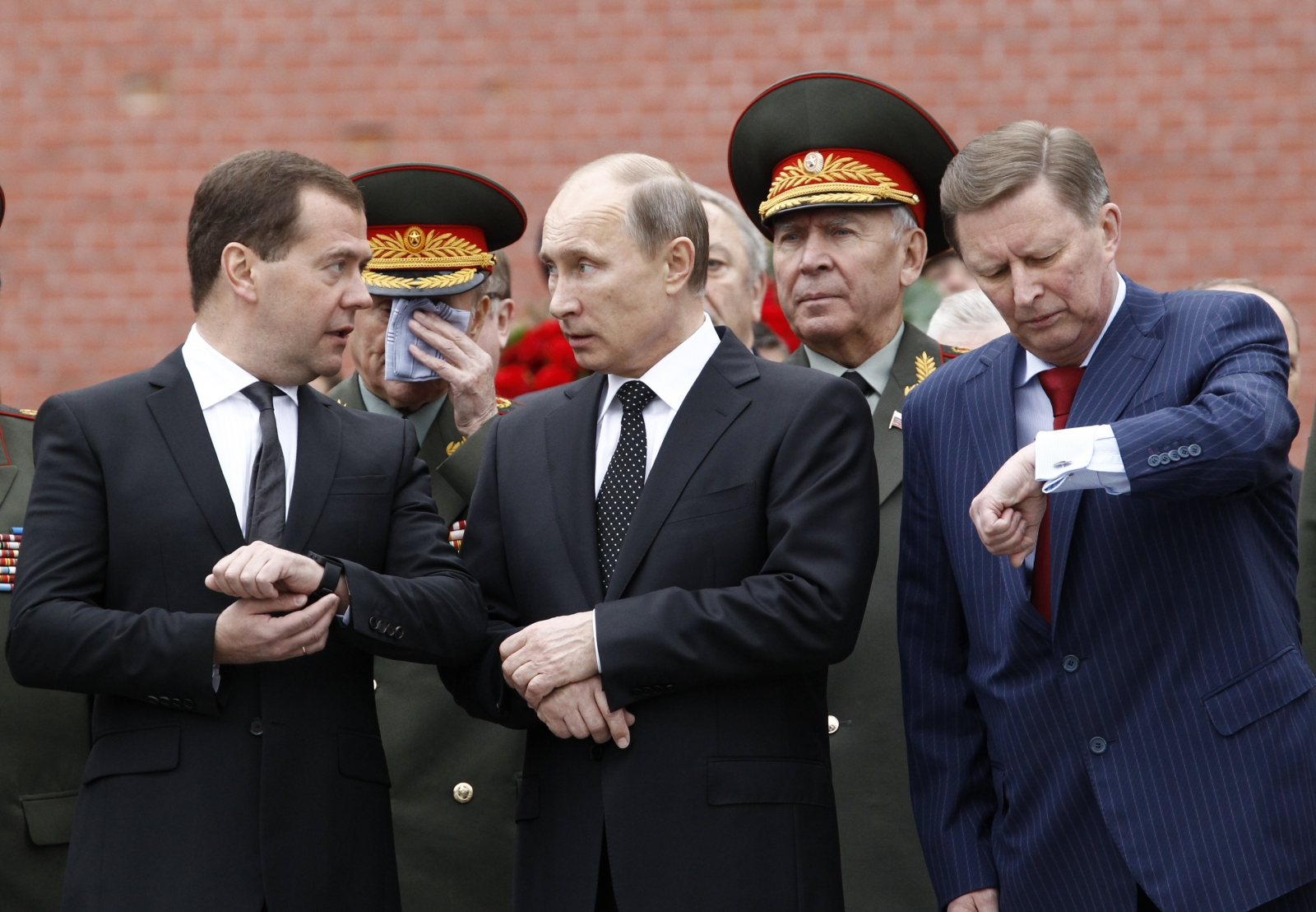 Russia\'s President Vladimir Putin (C), Prime Minister Dmitry Medvedev (L, front) and Chief of Staff of the Presidential Administration Sergei Ivanov (R, front)