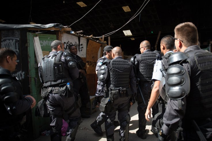 Brazilian gunman kills ex-wife, son and 12 others in New