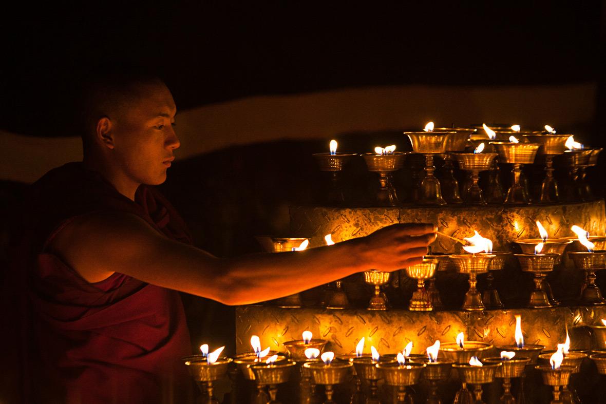 buddhist monk lamps