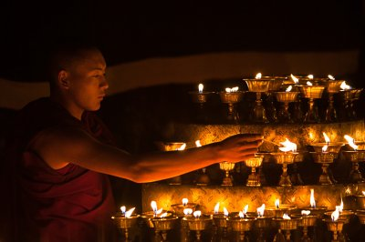 buddhist monk lamps