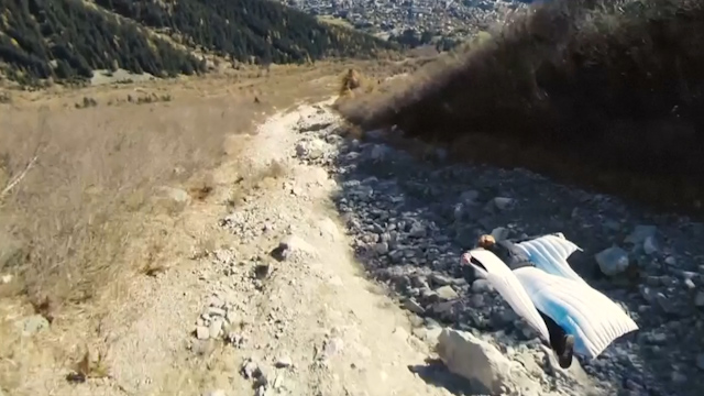 Daredevil wingsuit flyer performs 'high five' stunt in French Alps