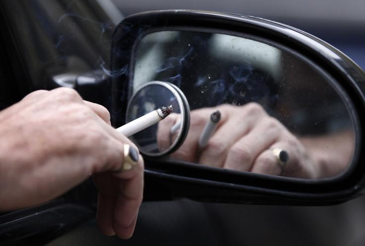 Man smoking in his car