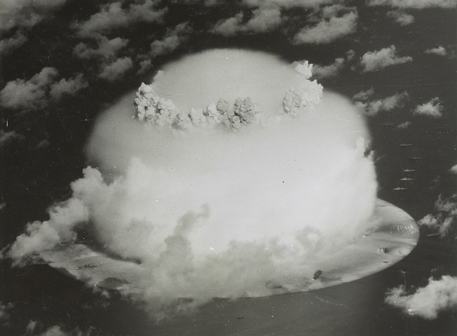 A mushroom cloud rises with ships below during Operation Crossroads nuclear weapons test on Bikini Atoll, Marshall Islands in this 1946 handout provided by the U.S. Library of Congress.