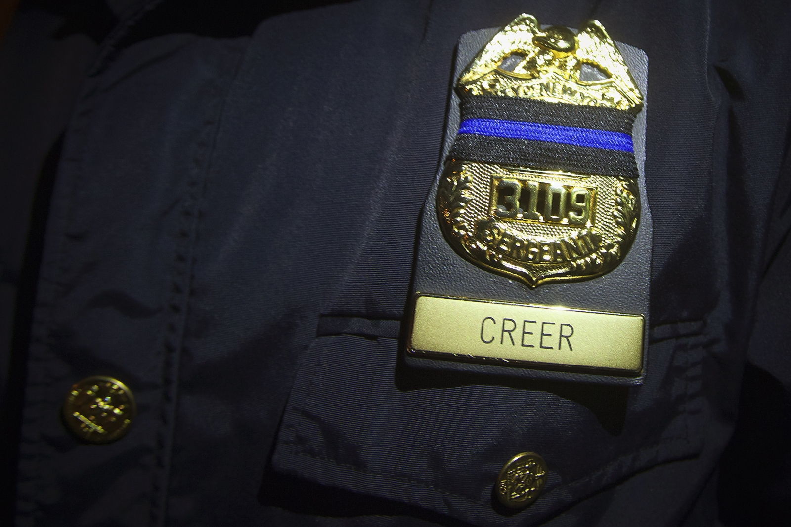 Black ribbon in mourning for the two dead officers