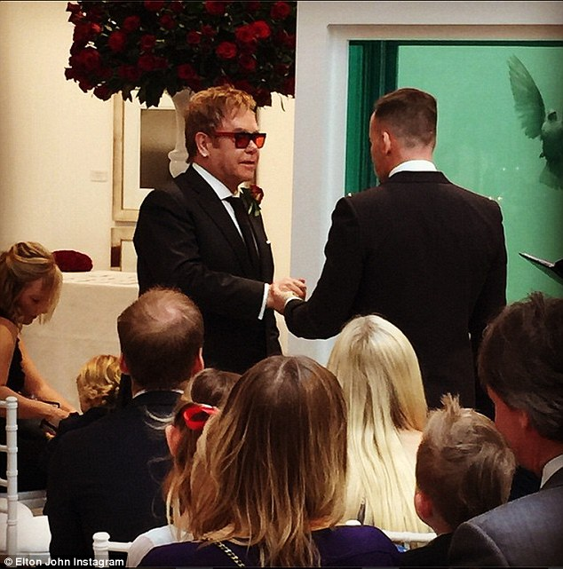 Sir Elton John and David Furnish exchange their wedding vows