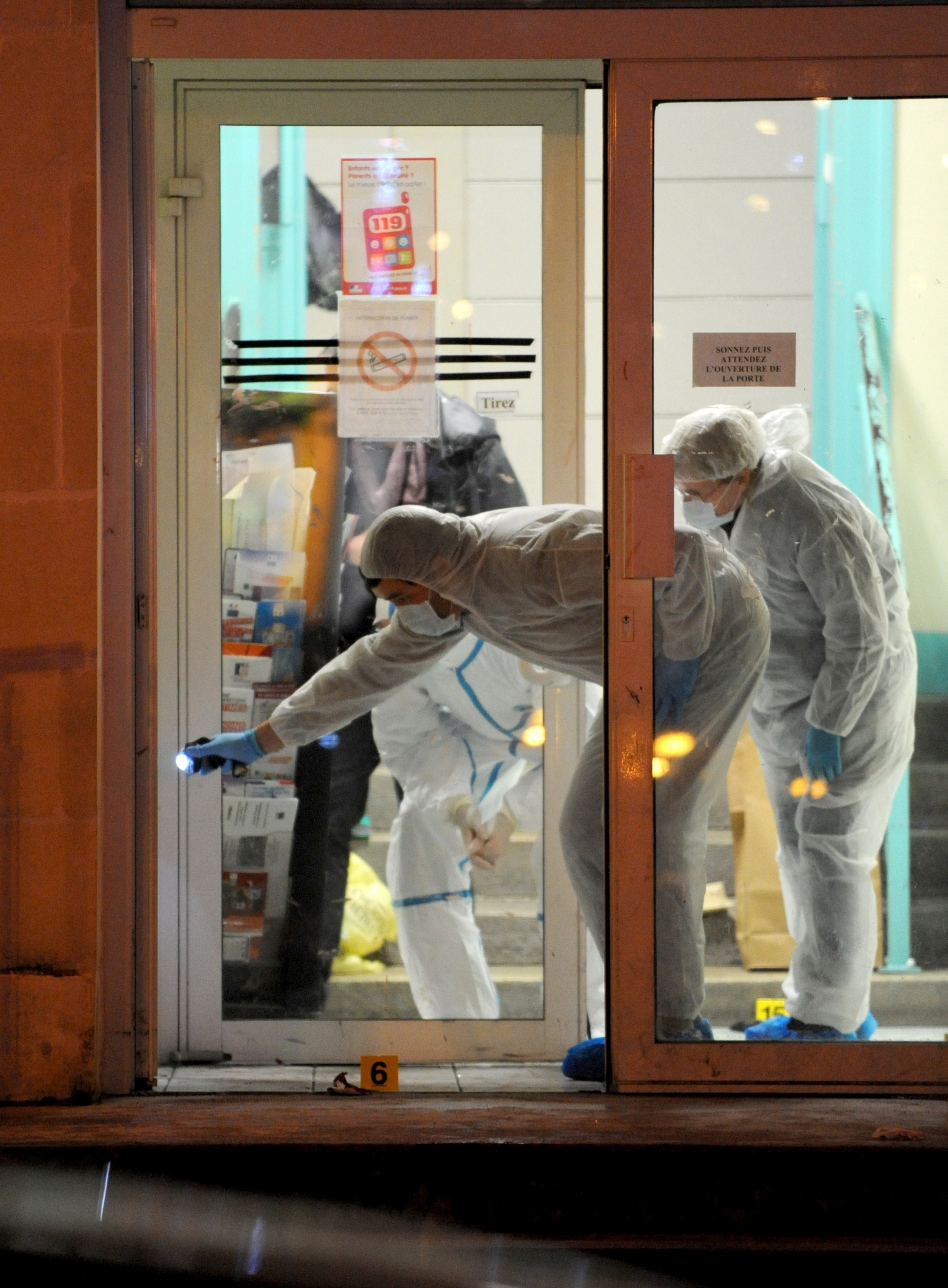French police investigate the scene of yesterday's stabbing. (Getty)