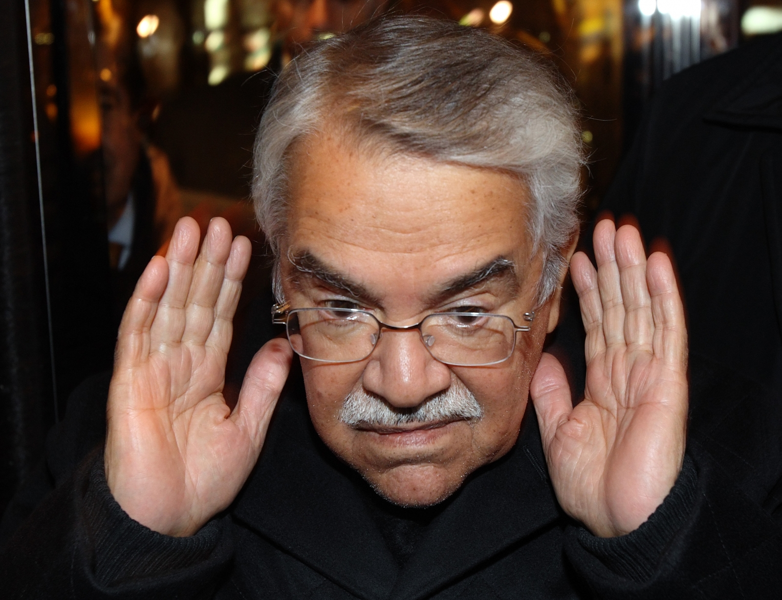 Saudi Arabian Oil Minister Ali al-Naimi gestures as he arrives at his hotel