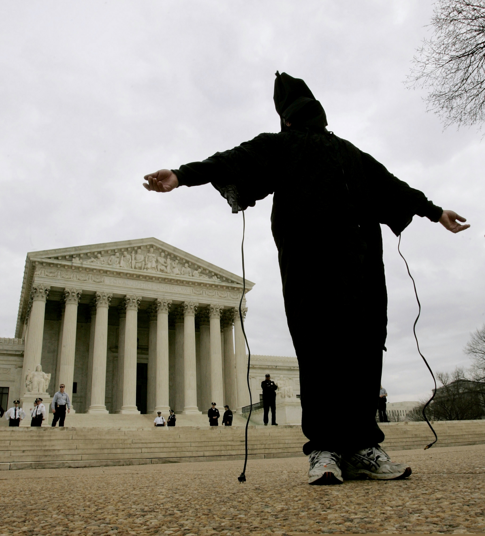 An activist recreates one of the infamous images of detainee abuse in Iraq's Abu Ghraib prison outside the US Supreme Court (Reuters)