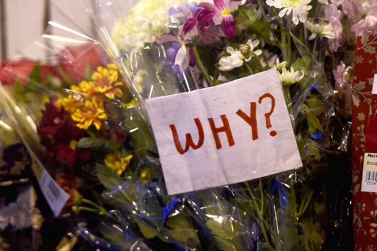 Floral tributes are placed near to the scene of yesterday's bin lorry crash