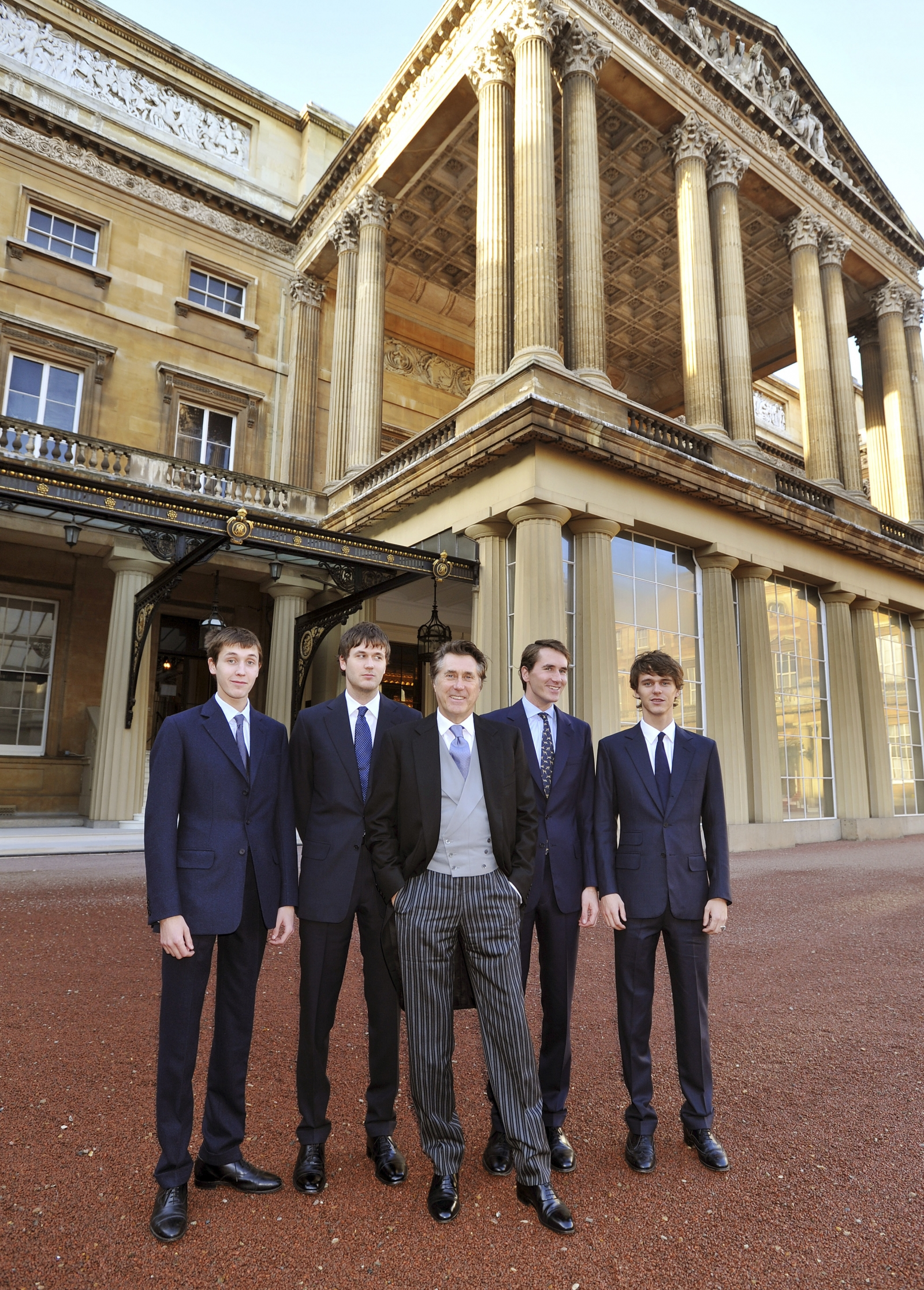 Bryan Ferry (C), poses for a photograph with his four son's (L-R) Merlin, Isaac, Otis and Tara