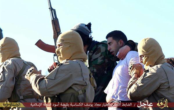 Pictures allegedly showing a Jordanian pilot being taken hostage by militants after his plane was shot down near Raqqa, Syria.