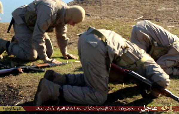 Militants pray after allegedly taking a Jordanian pilot hostage  near Raqqa, Syria.