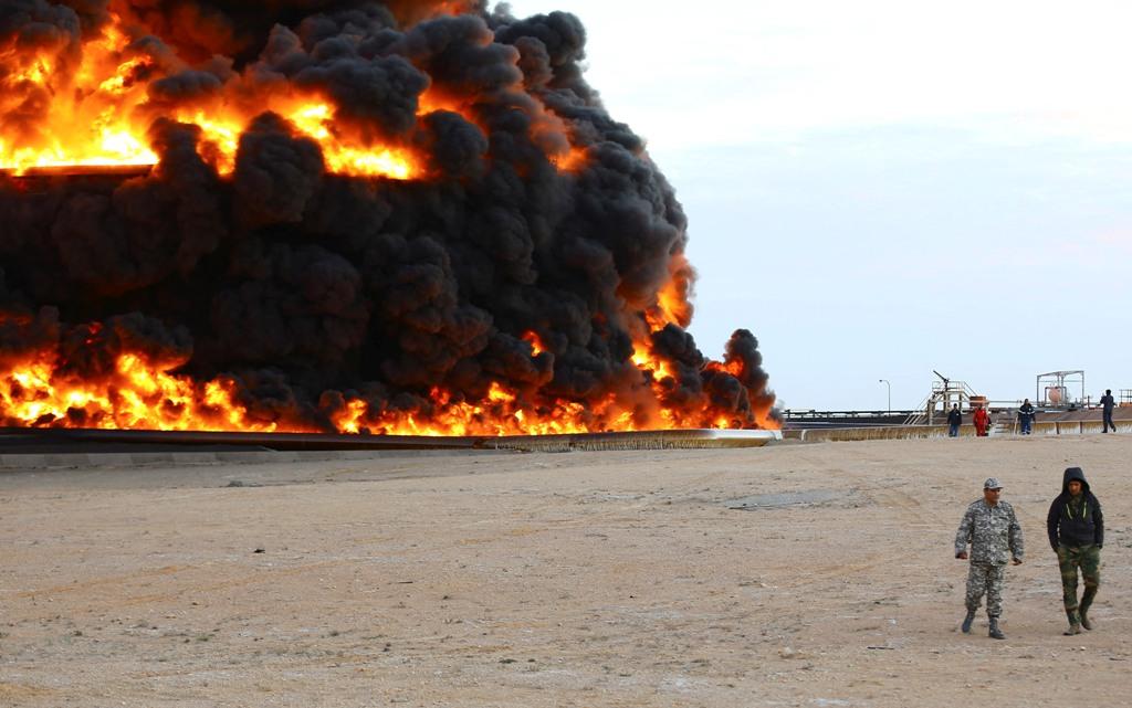 An oil tank burns in Libya's Es Sider port on 26 December