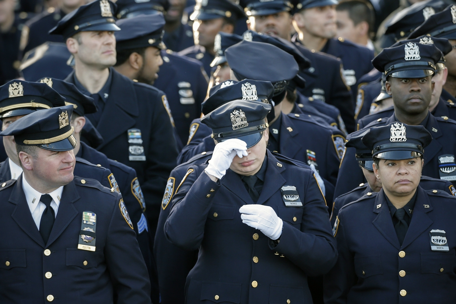 Policemen line-up near the Christ Tabernacle Church