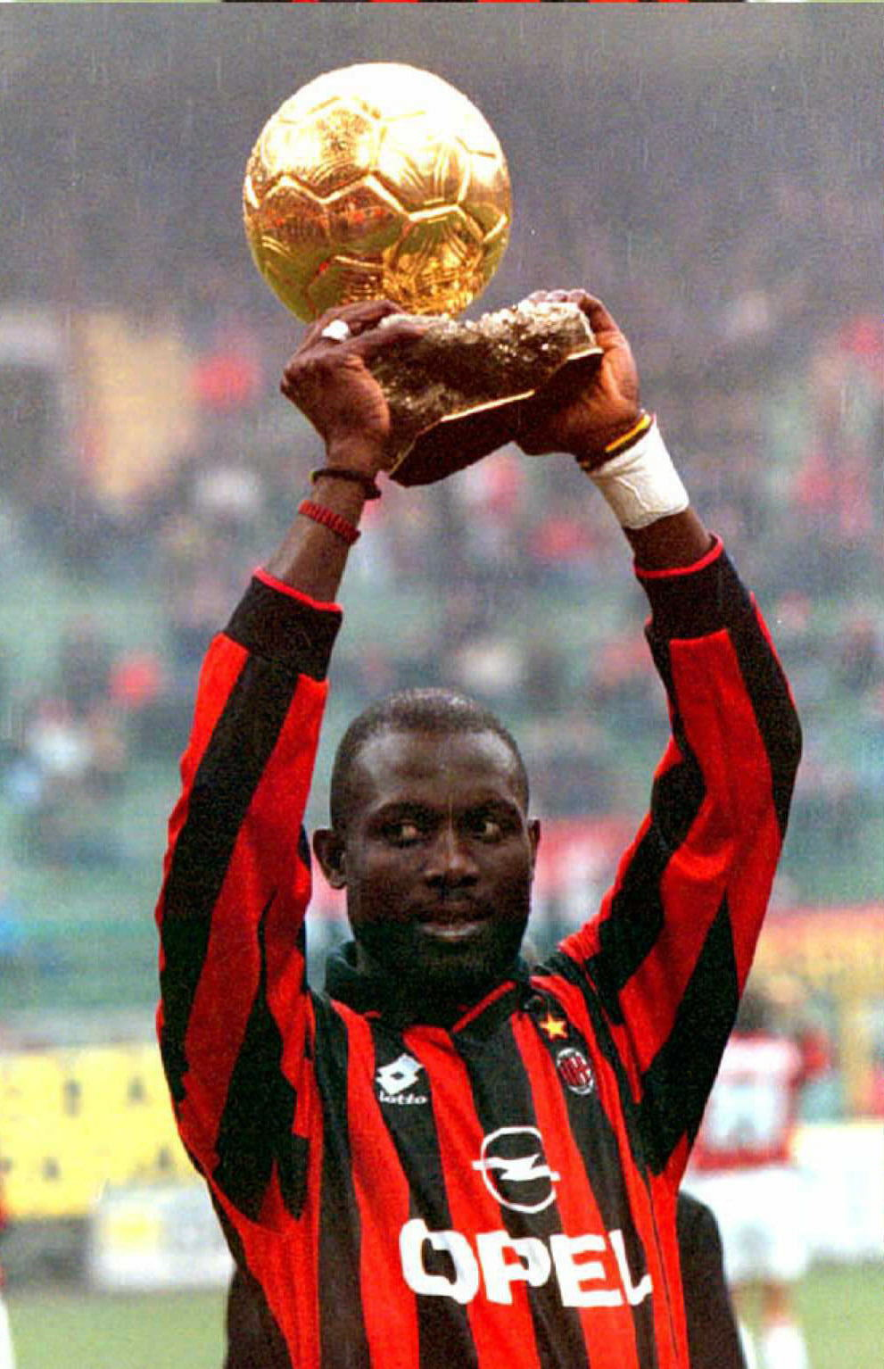 George Weah holds aloft the Eurpean player of the Yera award in 1996. (Getty)